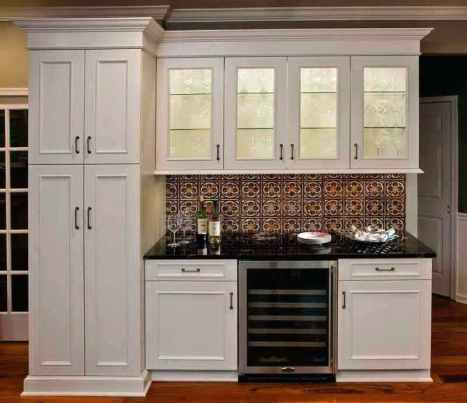 Tin Backsplash with White Cabinets